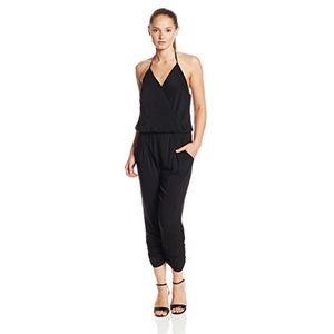 Eight Sixty Surplice Black Jumpsuit | Medium
